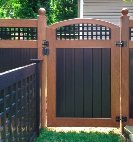 curved-black-and-wood-fence-vinyl