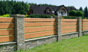 Durable fence made of wood and stone house enclosing