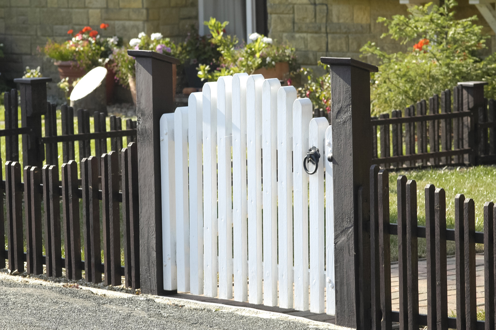 white wooden gate and low fence