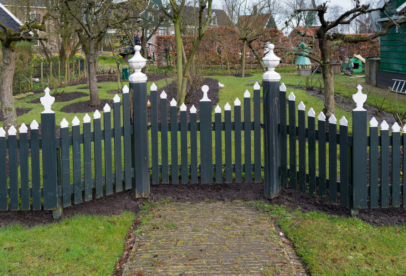 traditional green wooden fence